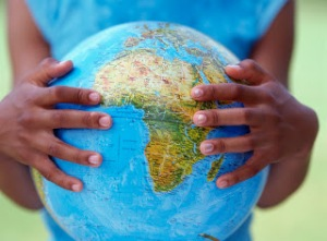 Girl's hands holding globe --- Image by © Royalty-Free/Corbis
